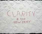 Clarity IS the New Sexy: mixed media w/threaded text message on paper.