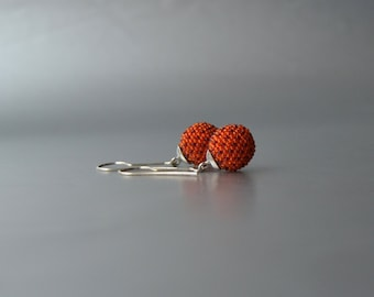 beadwork and silver earrings orange with red dots