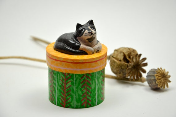 Round wooden trinket / treats box with a sleeping cat on top