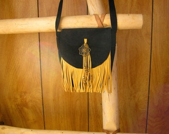 "Black Suede and gold deerskin leather purse with brass medallion and fringe, 6"" x 4 1/2"" x 2"", with 17"" strap"