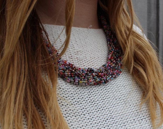 Multi coloured rainbow statement necklace.