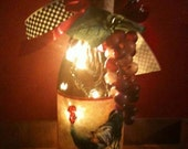 Lighted Rooster Wine Bottle with Black and White Checked ribbon, Satin bow, grapes and an accent cork.