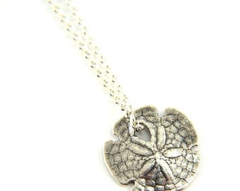 Silver sand dollar necklace - delicate necklace - a dainty silver sand dollar hanging from a  sterling silver chain