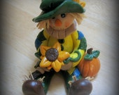 Polymer Clay Scarecrow Holding Sunflower