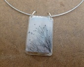 Black and White photograph Birds Taking Wing from a Tree clear resin pendant