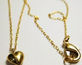 Heart pendant on gold chain
