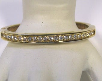 Vintage Rhinestone Hinged Bangle Bracelet in Gold tone metal
