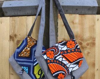 Orange African Wax print kid size messenger bag. 1 inside pocket and button & elastic loop closure