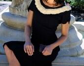 Black vintage dress with white fur trim