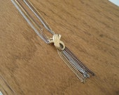 Vintage Avon gold and silver multi chain necklace.