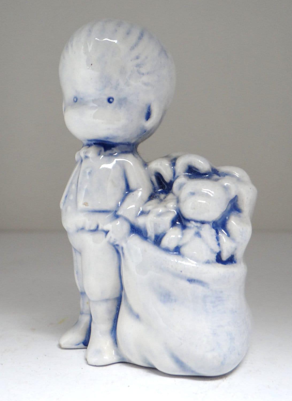 Vintage boy figurine boy with bag of toys ceramic figurine