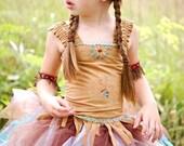 Indian Princess set. Polyester micro suede corset , tutu, arm bands, and headband.