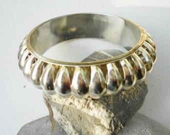 Vintage bangle, a 1970s geometric bangle bracelet, vintage chunky silvertone raised metal in modern minimalist style