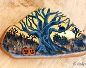 Acrylic painted rock with Spooky Halloween Scene