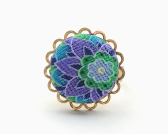 Precious purpleness, cute as a button: an adjustable ring adorned with a handmade fabric covered button
