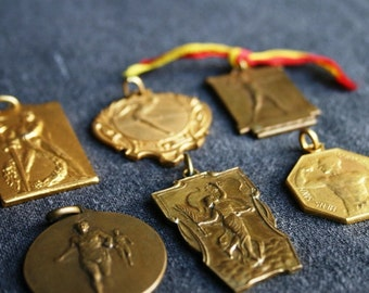 Golden medals. Antique sport rewards from the 1930s and 1940s. Track and field collectibles.
