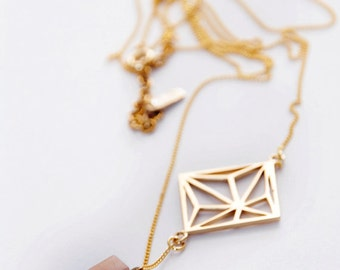 Gold Geometric and Crystal Necklace.