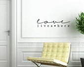 Love lives here. Custom Vinyl Wall Decal.
