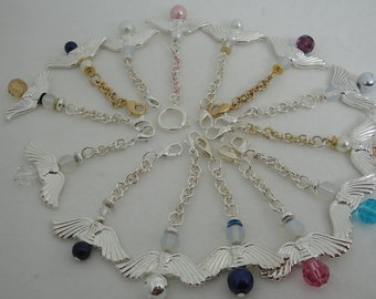Pretty metal crystal Angels made a chain to be with you or placed any where you would Like.