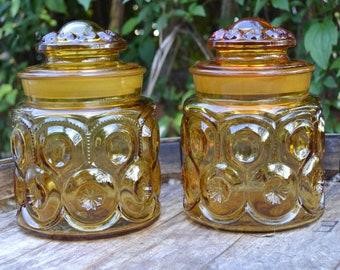 Pair of L E Smith Moon and Stars Amber Canisters