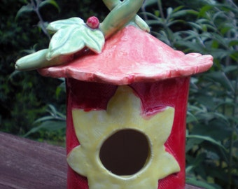 Hand sculpted ceramicYellow Flower Orange and Red Birdhouse