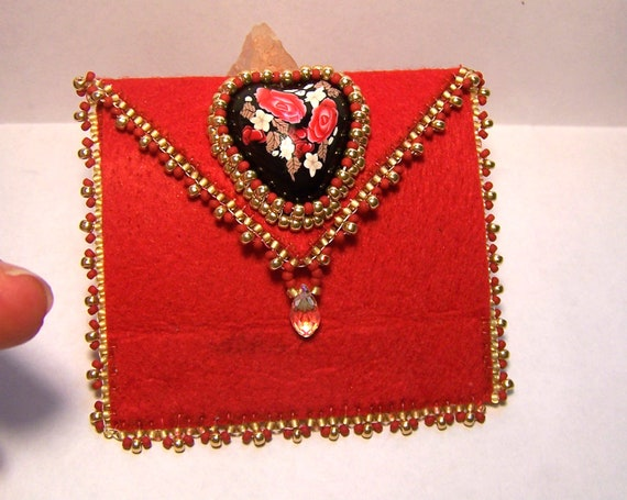 Bead embroidered hand sewn needle book case featuring handmade heart cabochon