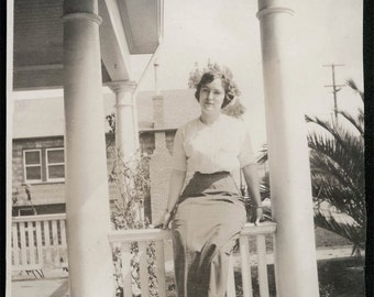 vintage photo Young Lady sits on Porch Railing TRee Crown