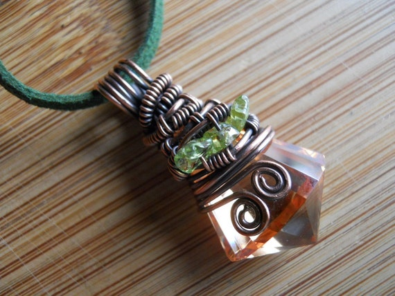 Wire Wrapped Pendant Golden Light Orange Cubic Zirconia Faceted Drop with Green Peridot beads in Oxidized Copper wire