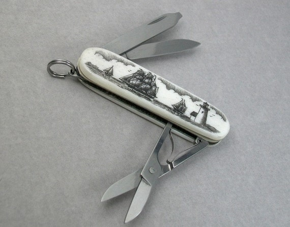 Scrimshaw Swiss Army Knife with bone handles and Nautical Scene featuring Lighthouse and Ships