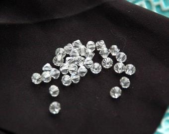 32 Swarovski 5mm 5301 Crystal Clear Bicone Beads