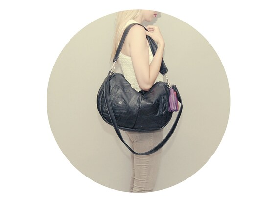 FURROW /// black leather slouchy bag with raspberry and purple tassel
