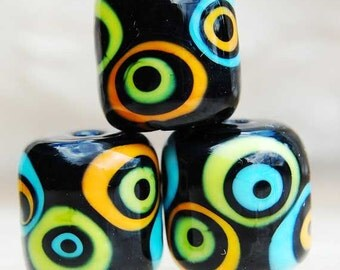 Rizzolinis, 2 black barrel beads with orange, blue and green pattern, handmade glass beads by Beadfairy Lampwork, SRA