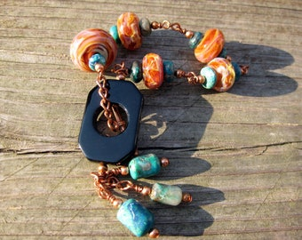 Chrysocolla & copper wire wrapped bracelet featuring artisan borosilicate lampwork and black onyx