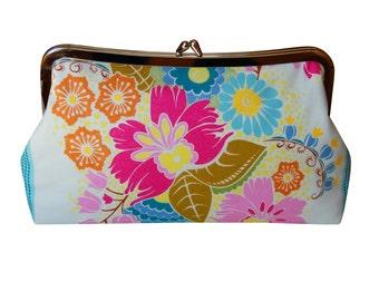 Clutch purse in summer flower garden