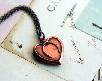 horseshoe. locket necklace. copper ox