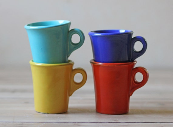 four vintage coffee cups