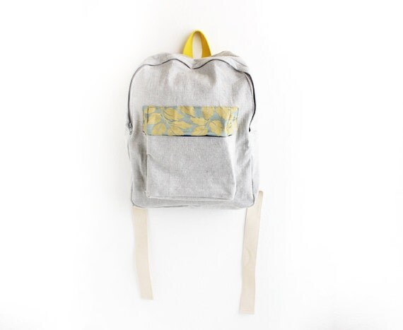 light grey denim backpack with blue and gold floral pouch