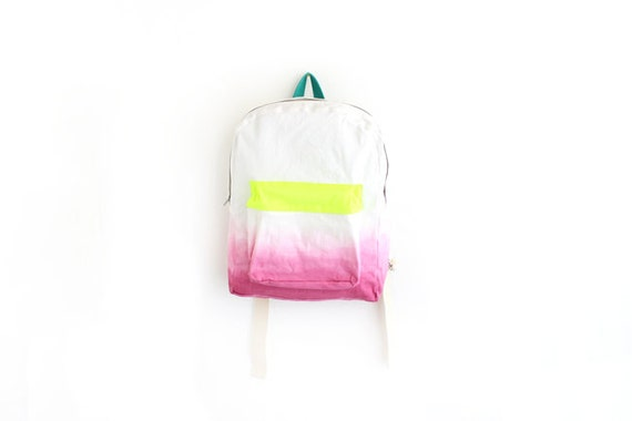 pink dyed backpack with neon yellow pouch