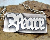 PEACE SIGN hand cut sterling silver word necklace by Crazy Daisy Designs