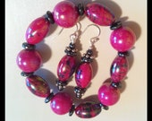 Hot pink fuscia and black beaded bracelet with matching pierced dangle earrings