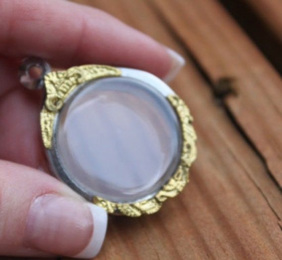 Gold tone etched detailed round shaped pendant. Victorian style locket, casing, display, frame