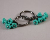 Clip on earrings, gunmetal-plated hoops, with Czech glass bell flowers Turquoise