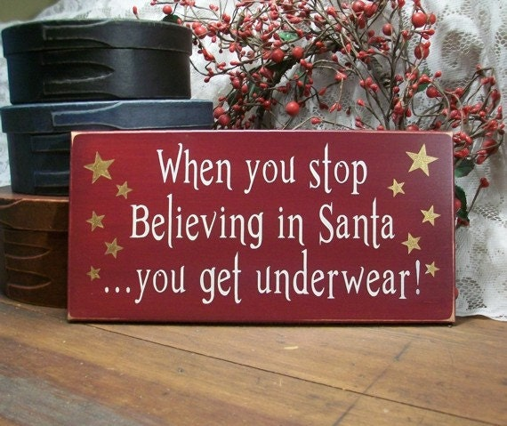 christmas wall sign stop believing in santa get by