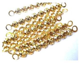 6 Vintage Swarovski crystal connector beads, 8 rhinestones in metal gold color setting- RARE