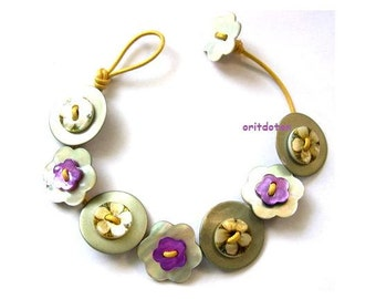 Bracelet button jewelry made of shell flowers buttons on yellow leather cord