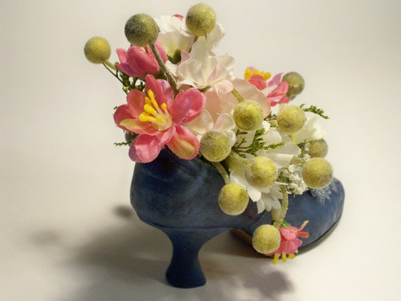 Petite silk flower arrangement in a blue princess high heel for Arrangement petite cuisine