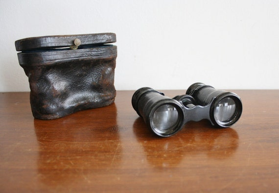 Vintage pair of binoculars with leather case