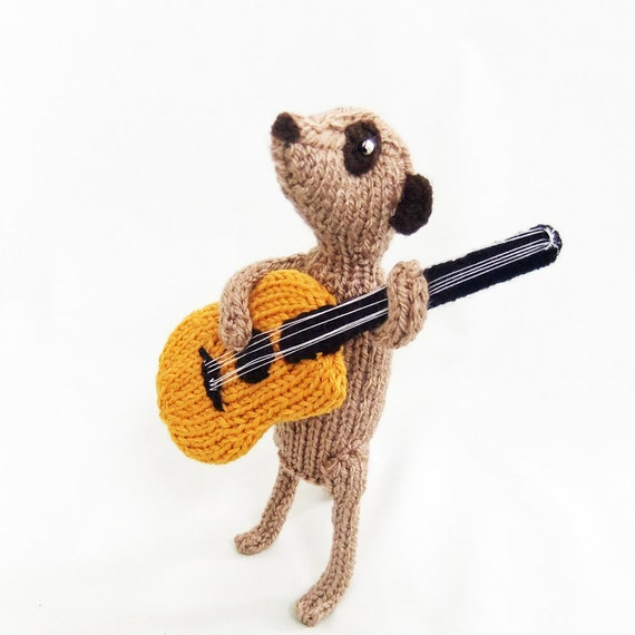 Meerkat with knitted acoustic guitar, guitarist meerkat, meercat guitarist, meerkat musician