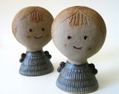Candle girls. Cute vintage candle holders.