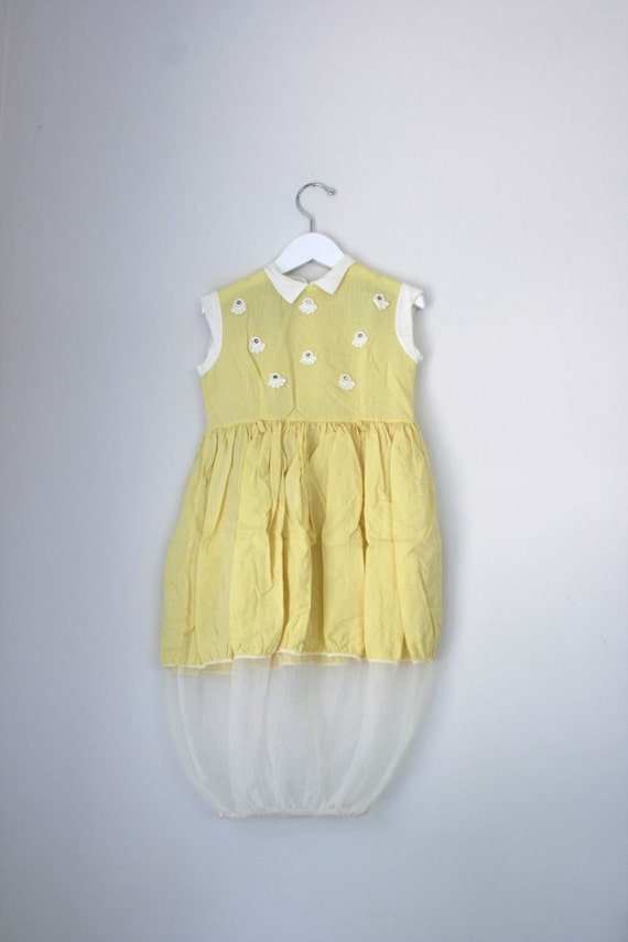 Vintage 1950's children's yellow dress with tulle skirt.